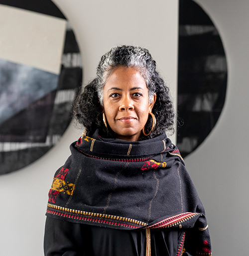 The artist Torkwase Dyson with installation *Nautical Dusk*, 2018. Photo by Gabe Souza courtesy of the Colby Museum of Art.